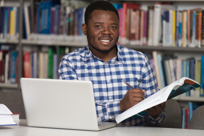 man smiling at the library
